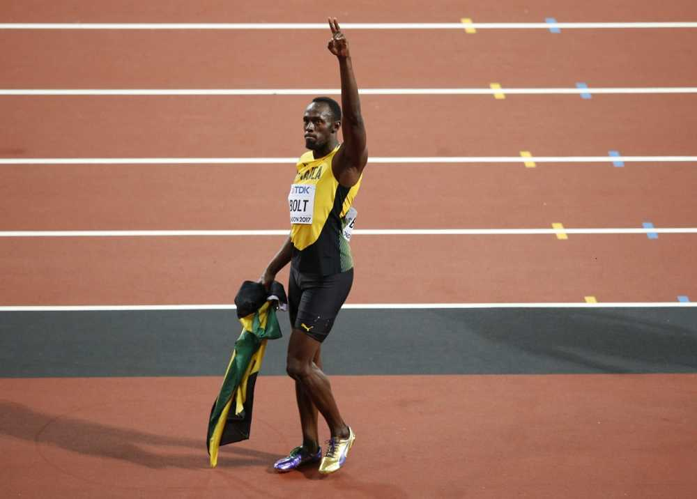 Jamaica's Usain Bolt bids farewell after placing third in the men's 100m final during the World Athletics Championships in London Saturday, Aug. 5, 2017. (AP Photo/Alastair Grant)